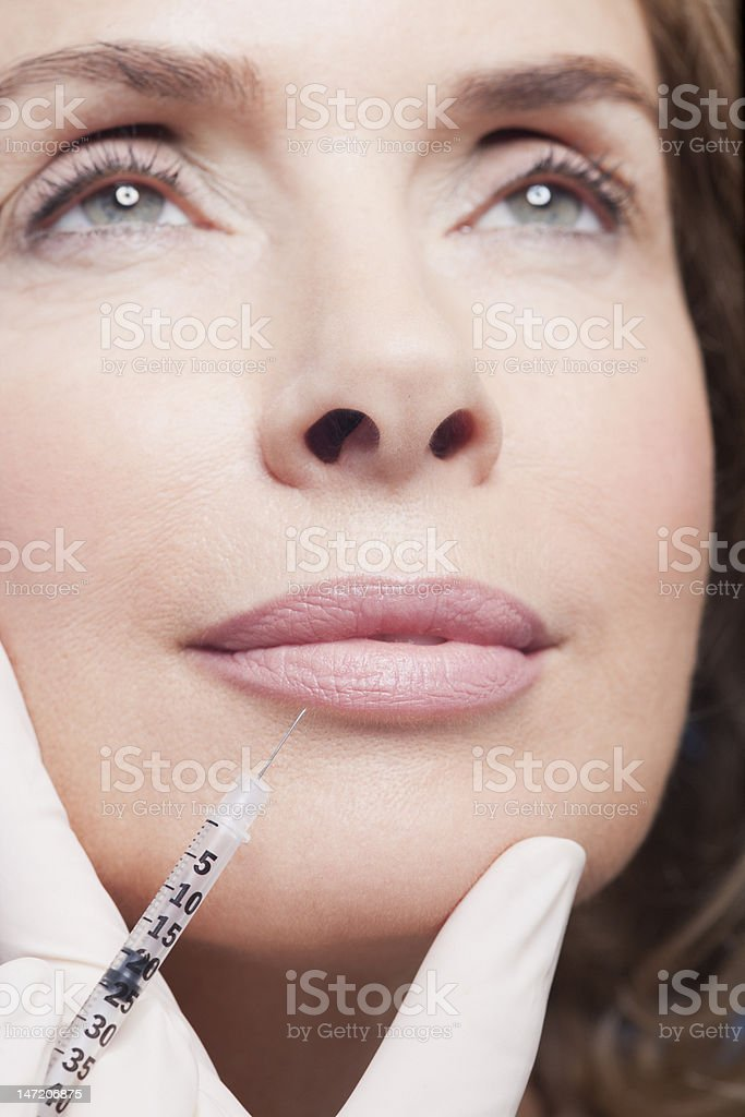 Close up of woman receiving botox injection royalty-free stock photo