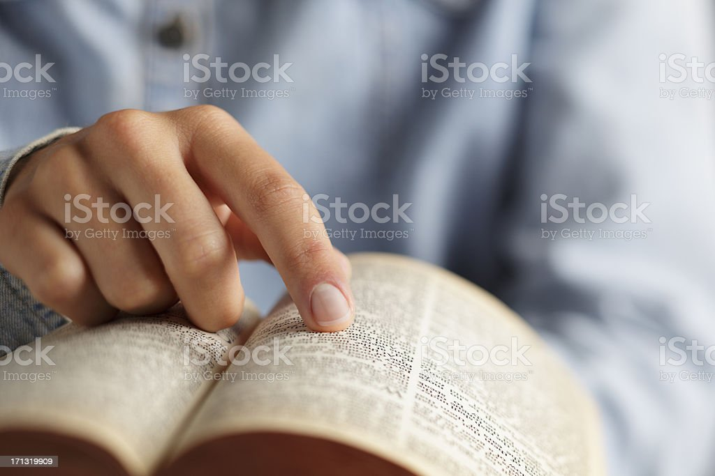 Close up of woman reding an open bible stock photo