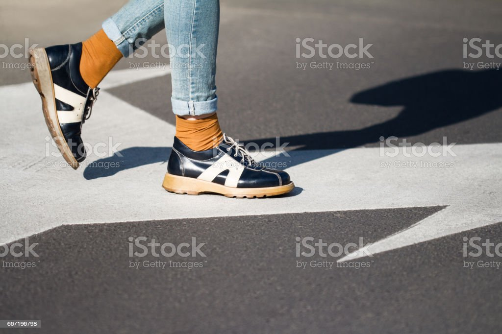 close up of woman shoes standing on the street stock photo