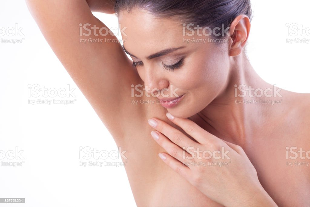 Close up of woman showing her armpit. stock photo