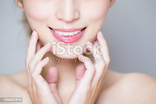 close up of beauty woman tooth on the gray background