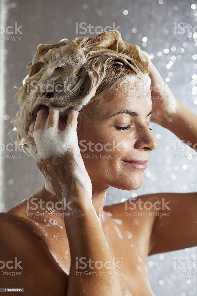 Close up of woman washing her hair in a shower. royalty-free stock photo
