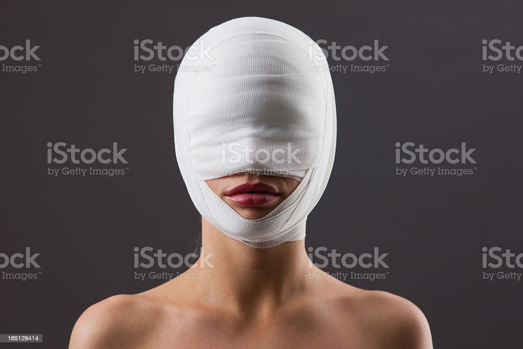 Close up of woman with bandaged face stock photo