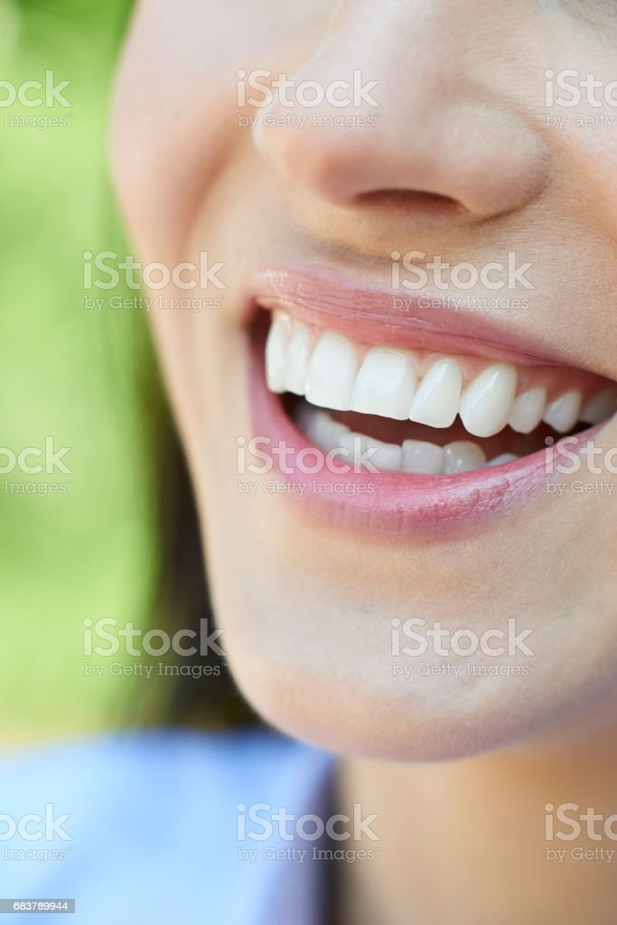 Close Up Of Woman With Beautiful And Perfect Teeth stock photo