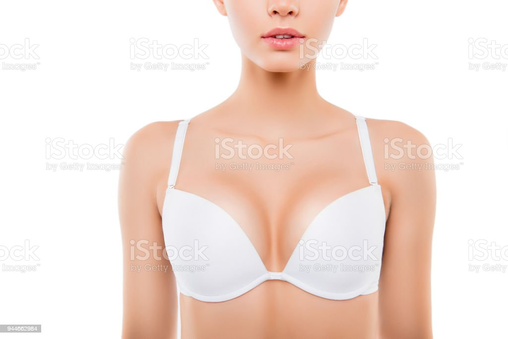 Close up of woman with perfect chest in white bra stock photo