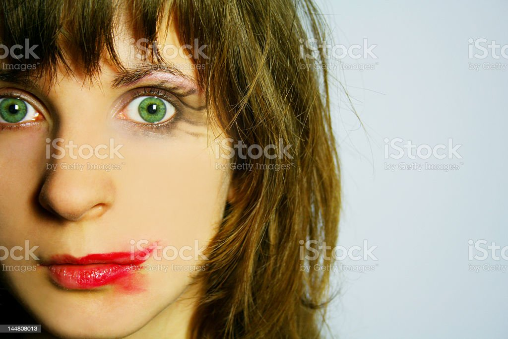Close up of woman with smudged lipstick staring stock photo