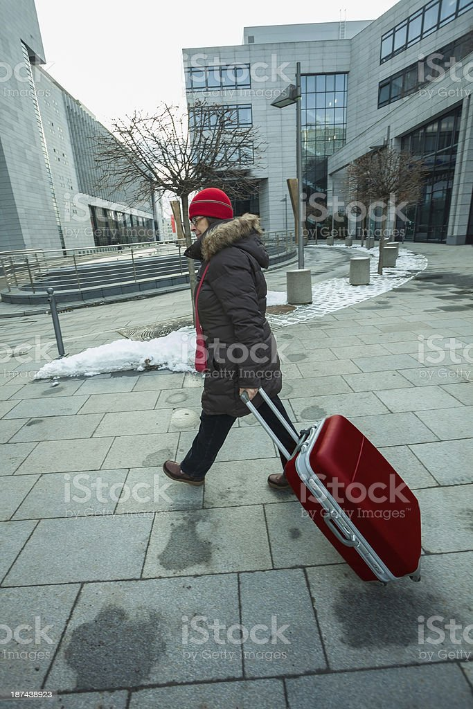 Close up of woman with suitcase walking royalty-free stock photo