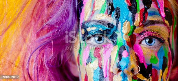 istock Close Up Of Woman's Face Covered In Dripping Paint 530495012