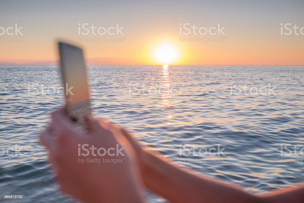Close Up Of Womans Hand With Mobile Phone On Beautiful Sunset Background Stock Photo Download Image Now Istock