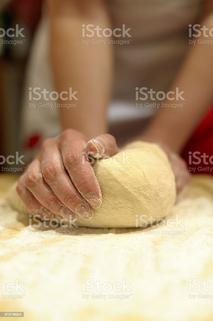 Close up of woman's hands kneading dough on counter royalty-free stock photo