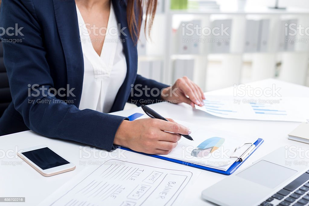 Close up of woman's hands. She works with documents royalty-free stock photo