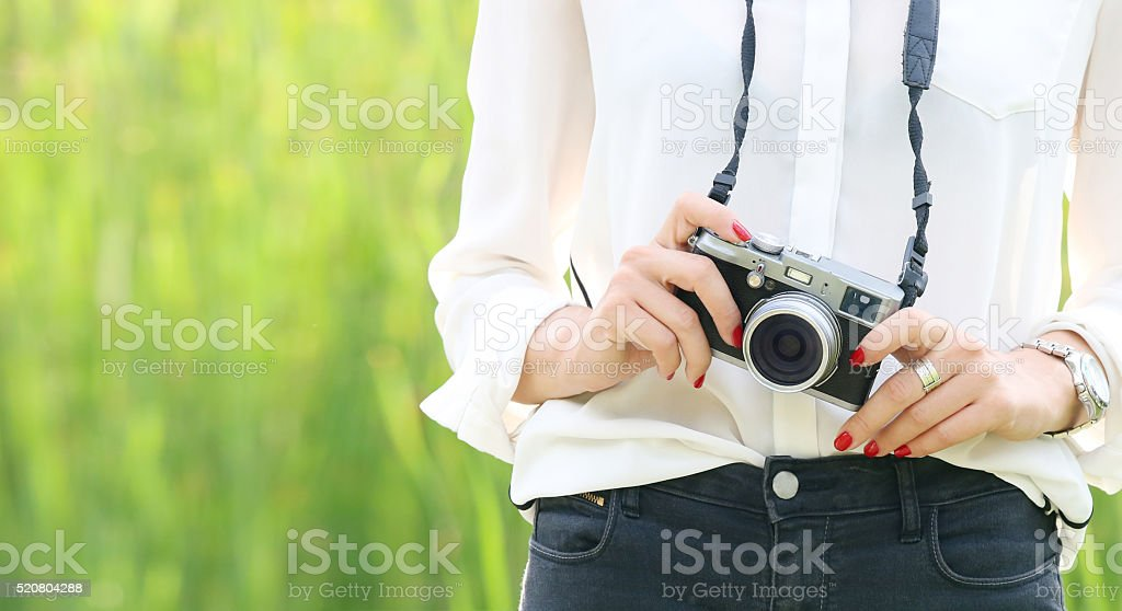 Close up of woman's hands with old camera stock photo