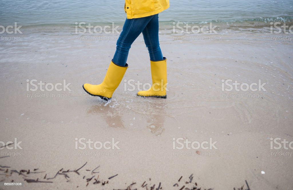 Close up of woman's rubber boot's stock photo