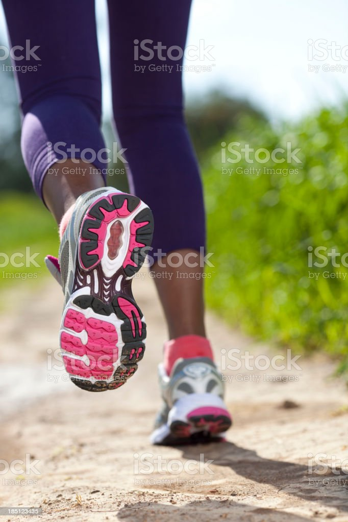 Close up of women sport shoes running outdoors. stock photo
