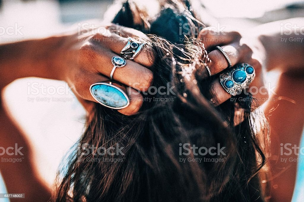 Close Up Of Women With Bohemian Style Jewelery Rings On Stock
