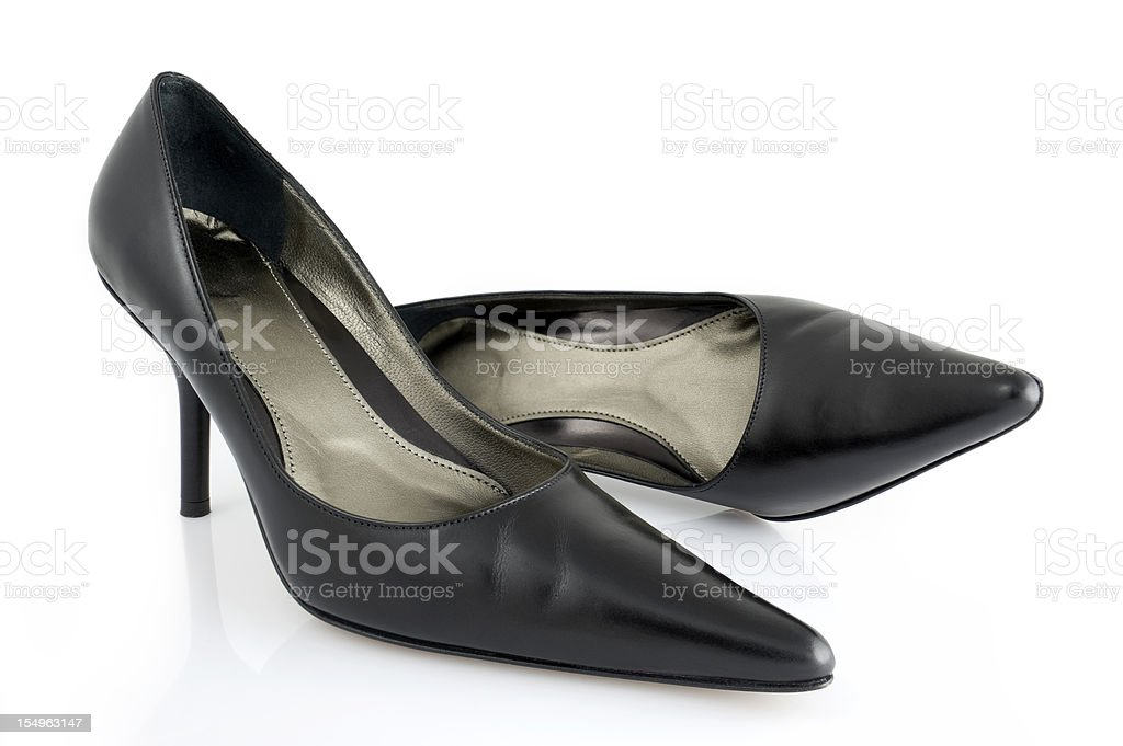 A close up of women's black high heel shoes royalty-free stock photo