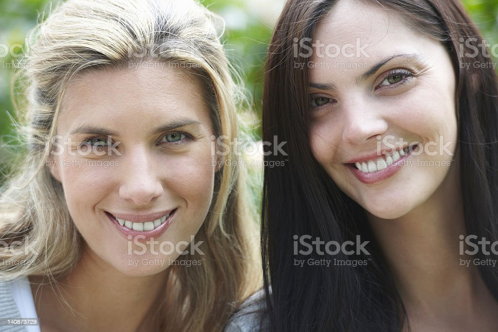 Close up of womens smiling faces stock photo