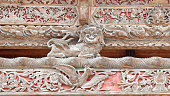 Bird carved wooden door in the traditional Thai style of the Thai church.