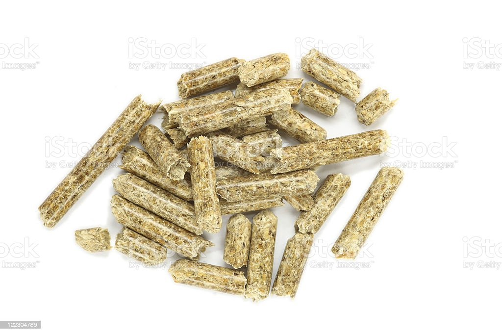 close up of wood pellets isolated on white royalty-free stock photo