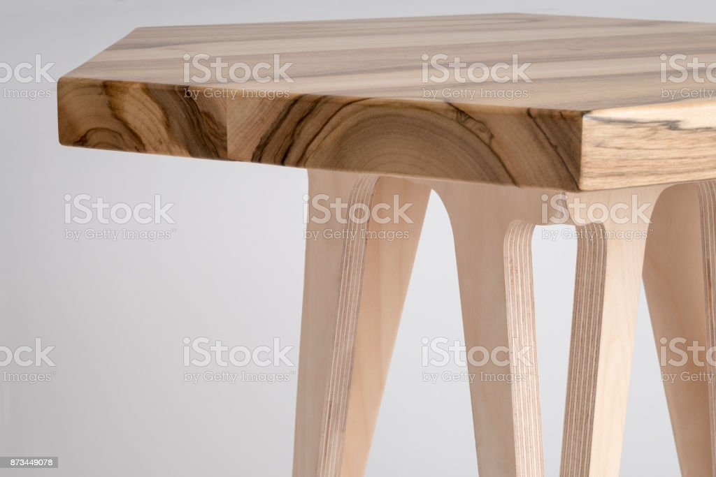 Close up of Wooden Coffee Table with Hexagonal Top stock photo