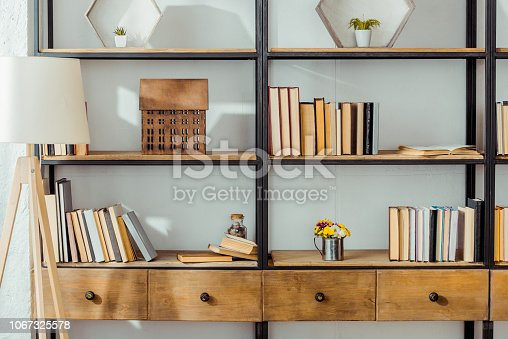 close up of wooden rack with books in living room