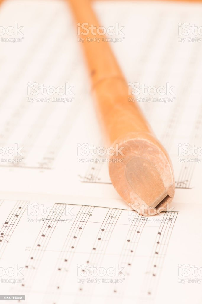 Close up of wooden recorder and music notes 免版稅 stock photo