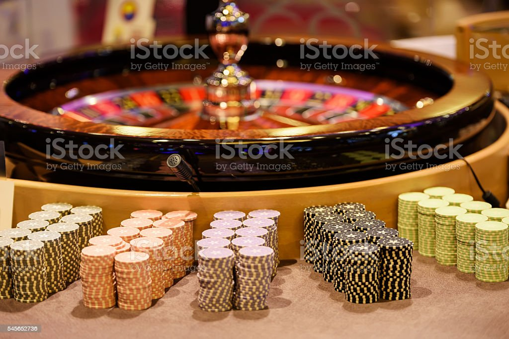 Close up of wooden roulette and chips in casino stock photo