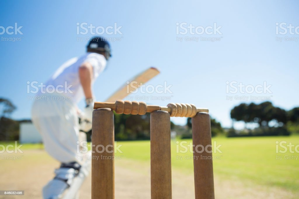 Close up of wooden stump by batsman standing on field stock photo