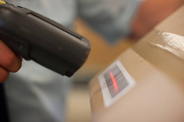 Close up of worker scanning box stock photo