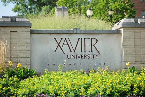 Cincinnati, Ohio, USA - August 9, 2015: Sign at the entrance to Xavier University Founded 1831. Sign located on the roundabout on Ledgewood Road in Cincinnati.
