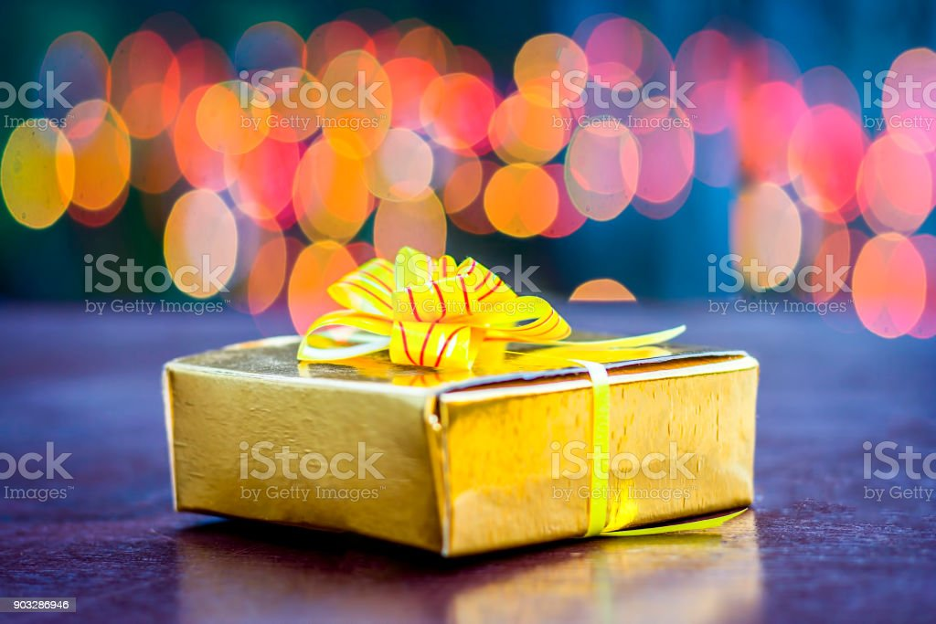 Close up of  Yellow gift box with red ribbon.Concept of Greeting with Best Wishes. stock photo