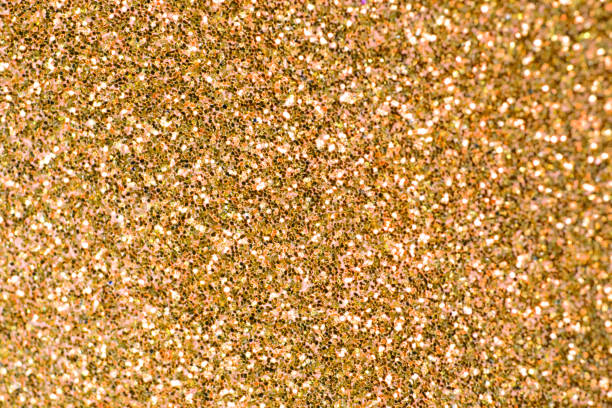 Close Up of Yellow Gold Glitter with Bokeh For Background stock photo