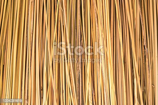 Close up of yellow striped straw texture as background.