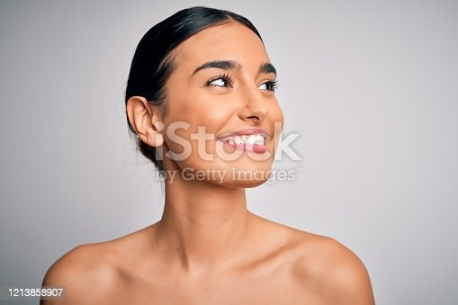 istock Close up of young beautiful woman with clear and pure skin. Perfect and clean skincare wearing natural makeup. Smiling happy looking fresh and healthy. 1213858907