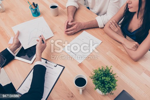 istock Close up of young broker showing contract for buying house 947134586