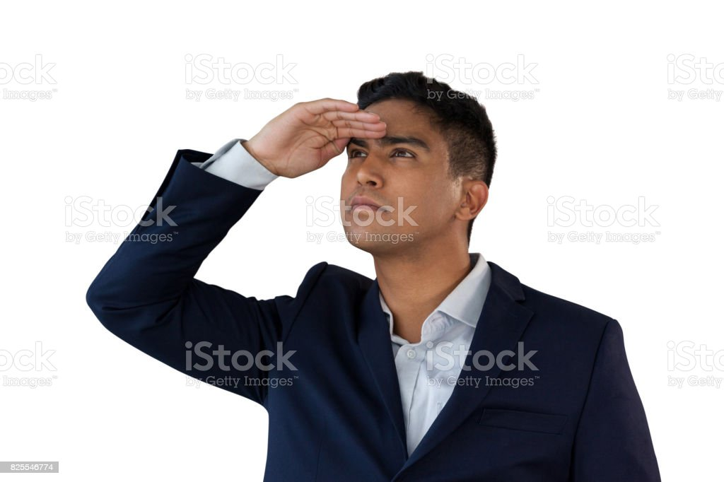 Close up of young businessman shielding eyes stock photo