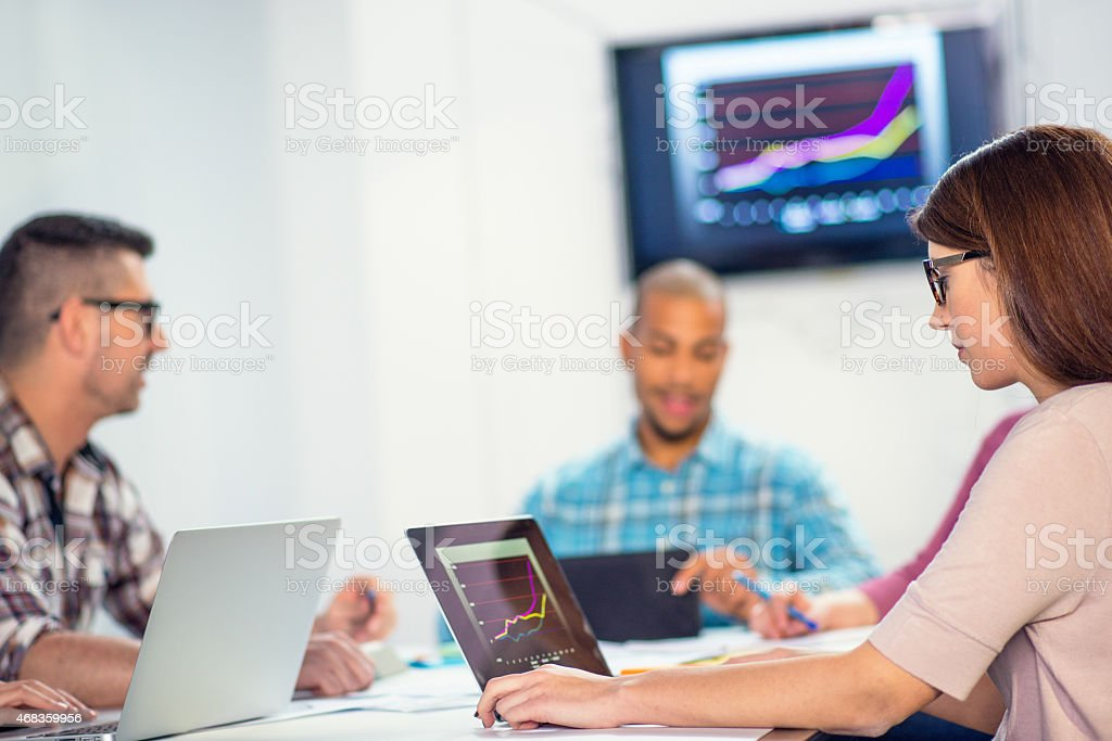 Close Up of Young Businesswoman Using Laptop During Board Meeting royalty-free stock photo
