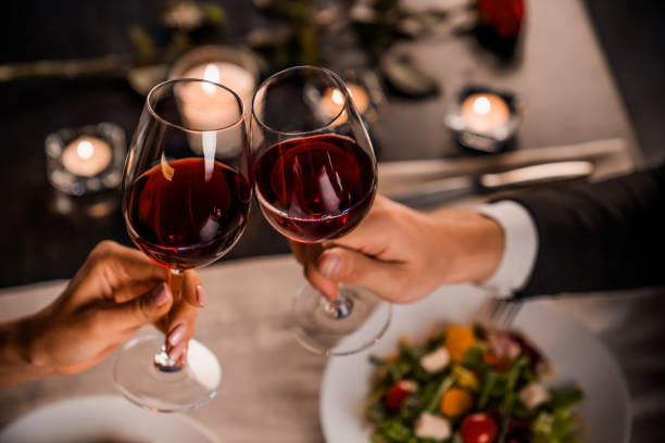Close up of young couple toasting with glasses of red wine at restaurant Couple, Romantic, Dinner, Togetherness, Holiday grace stock pictures, royalty-free photos & images