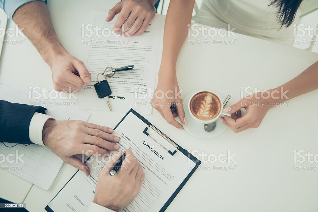 Close up of young family signing contract for buying house stock photo