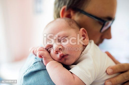 istock Close up of young father holding his newborn baby son 625686418