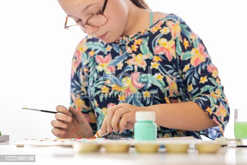 172382347 istock photo Close Up Of Young Girl Doing Art Class 1222486156