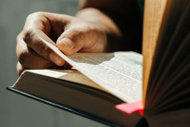 Close up of young man hands hold and reading holy bible.Christian faith concept