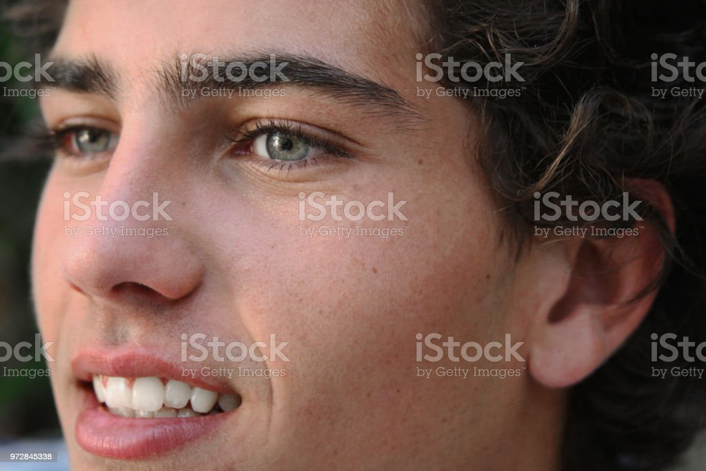 Close up of young man in half-profile stock photo
