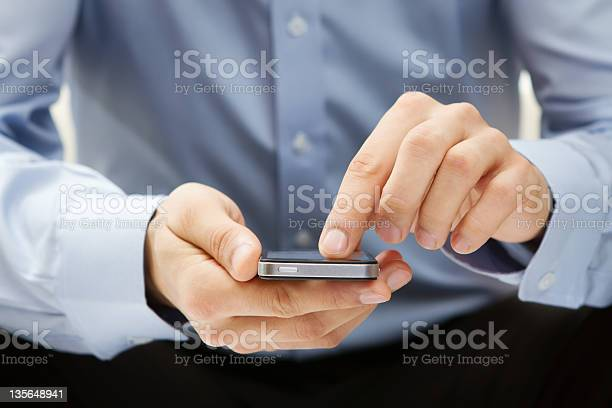 Close Up Of Young Man Using A Smart Phone Stock Photo - Download Image Now