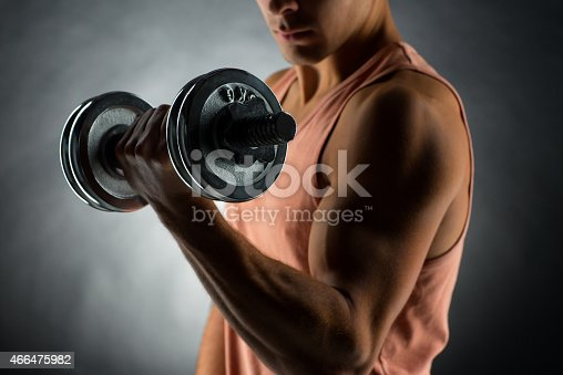 istock close up of young man with dumbbell 466475982