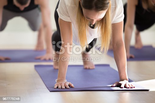 914755448istockphoto Close up of young sporty woman in Plank pose 967775248