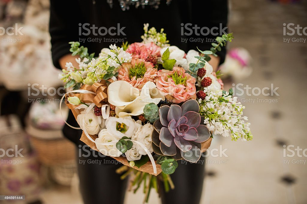 close up of young woman holding bouquet stock photo