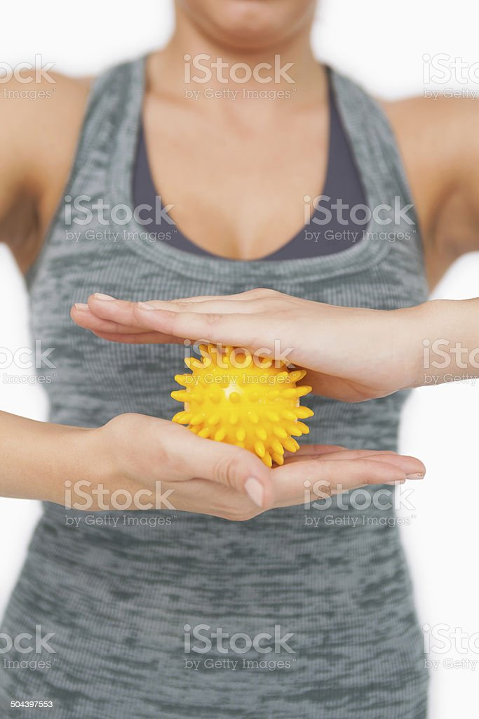 Close up of young woman holding yellow massage ball stock photo