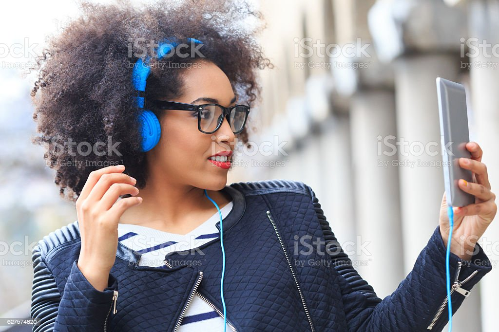Close up of  young woman making selfie with digital tablet stock photo