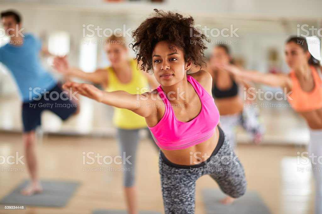 Close up of young woman on stretching training indoor royalty-free stock photo